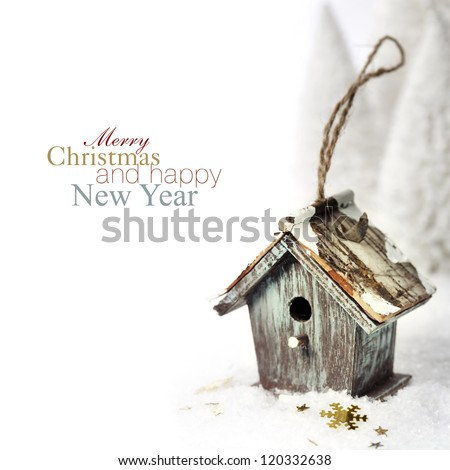 Bright christmas composition with small bird house (with easy removable sample text) - stock photo