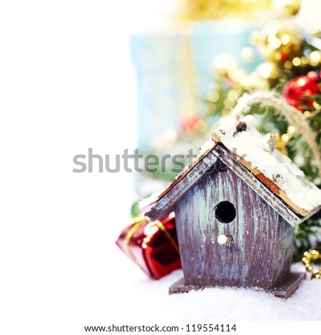 Bright christmas composition with small birdhouse - stock photo