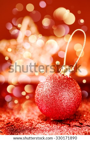 Bright Christmas Decorations with Red Shining Bauble, Red and Golden Stars and Glitter and Bokeh Lights. Selective Focus. - stock photo