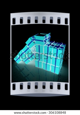 Bright christmas gifts on a black background. The film strip - stock photo