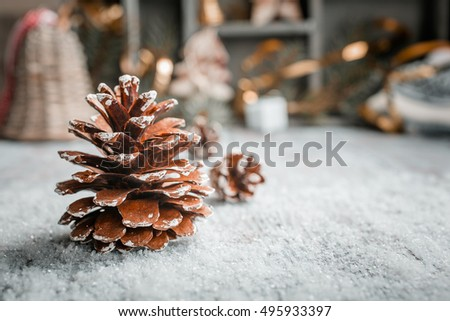 Bright christmas greeting card with pinecone and decorations. Christmas concept with copy space for text. Retro style toned.