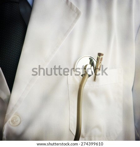 bright close up of male doctor with stethoscope - stock photo
