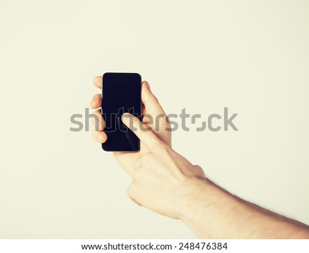 bright close up of man showing smartphone - stock photo