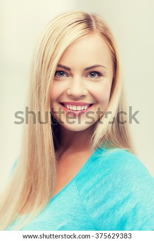 bright close up of smiling woman indoors