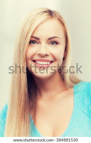 bright close up of smiling woman indoors - stock photo