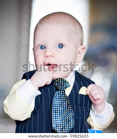 bright closeup portrait of adorable baby. Baby boy. - stock photo