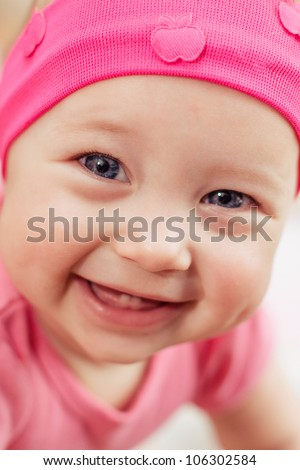 bright closeup portrait of adorable baby girl - stock photo