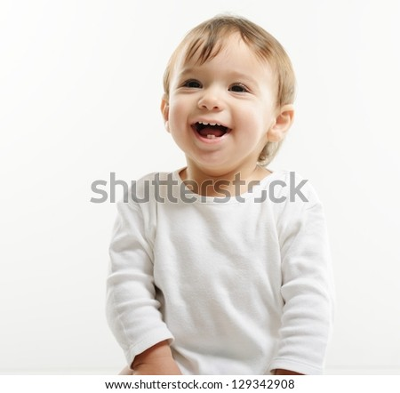 Bright closeup portrait of adorable happy baby - stock photo