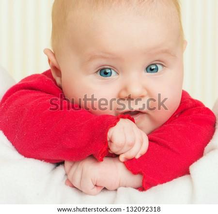 bright closeup portrait of cute adorable baby - stock photo