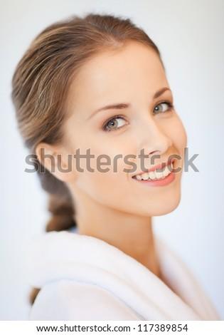 bright closeup portrait picture of beautiful woman in bathrobe - stock photo