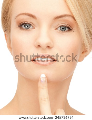 bright closeup portrait picture of beautiful woman. pointing to chin - stock photo