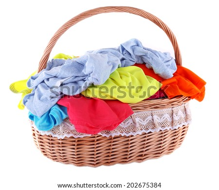 Bright clothes in laundry basket, isolated on white