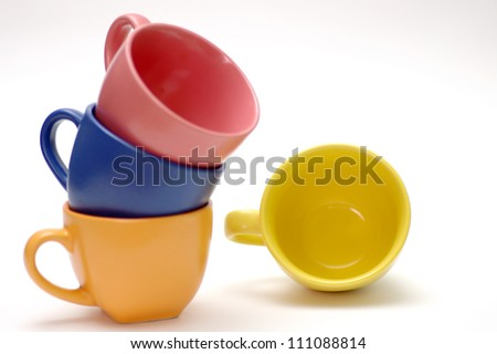 Bright coffee cups isolated on a white background - stock photo