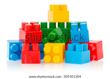 Bright color building blocks isolated on white background - stock photo