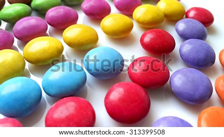Bright color candy close up on white background - stock photo