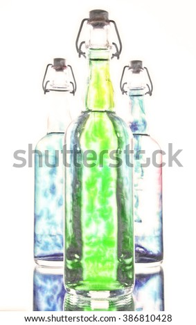 Bright color filled bottles - stock photo