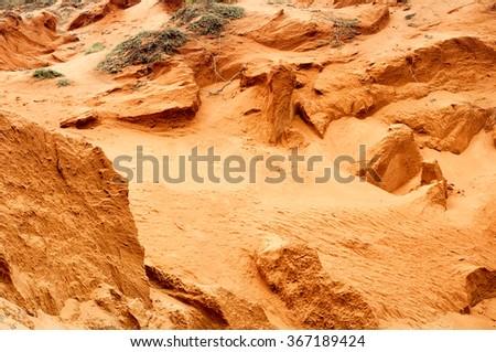 Bright color orange sand dunes texture as background - stock photo