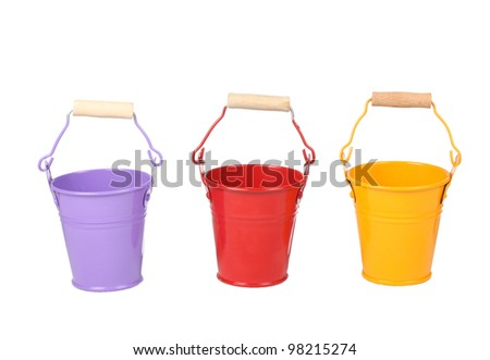 Bright color painted buckets - stock photo