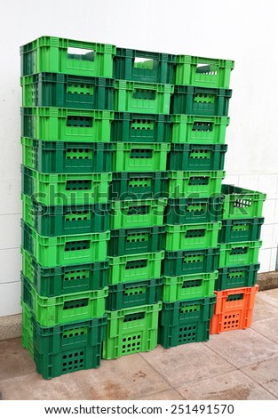 Bright Color Plastic Containers Piles beside supermarket - stock photo