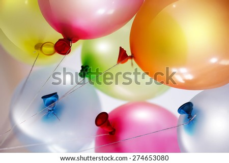 bright colored balloons on light background - stock photo