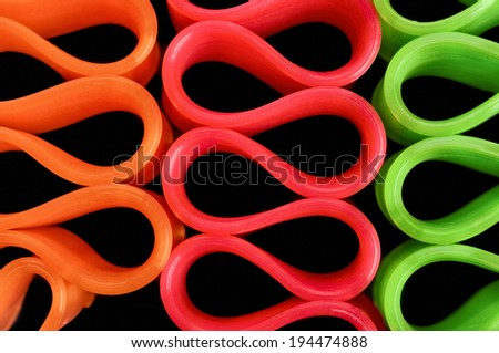 Bright Colored Closeup of Ribbon Candy on Black - stock photo