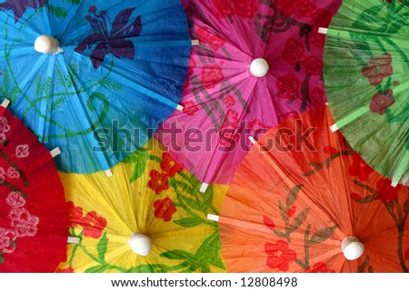Bright colored cocktail umbrellas - stock photo