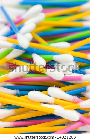 Bright colored cotton swabs background - stock photo