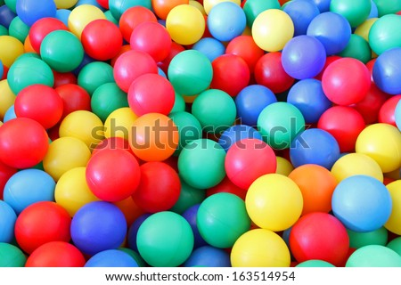 bright colored plastic ball in a swimming pool of a nursery to play