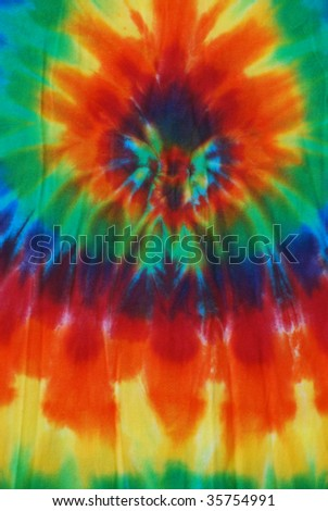Bright colored tie dye pattern on fabric.