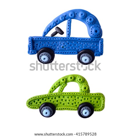 Bright, colorful cars. On a white background. Stuff is made from clay. - stock photo