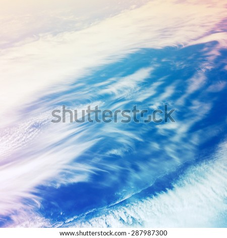 Bright colorful cloudy sky, stylized background photo texture with tonal filter correction - stock photo