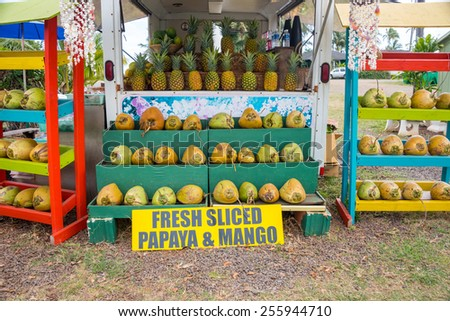Bright colorful coconut stand on town street - stock photo