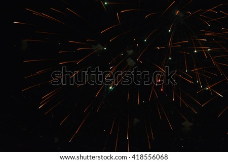 Bright colorful night volley salute. Fireworks on black background