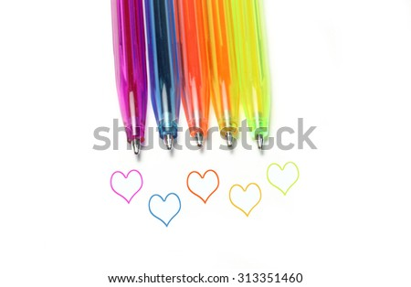 Bright colorful pens and abstract hearts on white background - stock photo