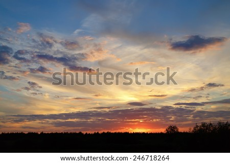 Bright colorful sky with clouds at sunset. - stock photo