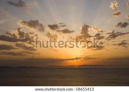 Bright colorful sunset on the sea with beautiful clouds ...