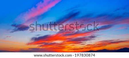 Bright colorful sunset on the sea with beautiful clouds. Panoramic. - stock photo