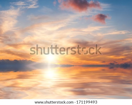 Bright colorful sunset over calm water