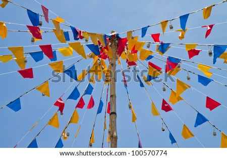 Bright colorful triangle flag banner above blue sky background