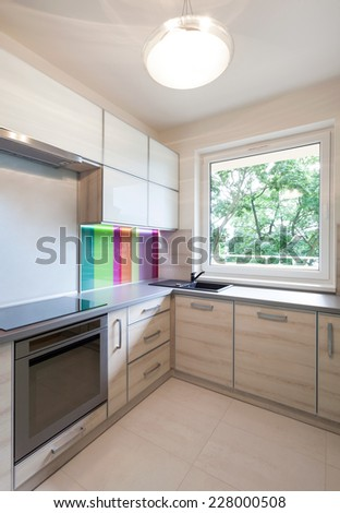 Bright colorfull contemporary kitchen in apartment - stock photo