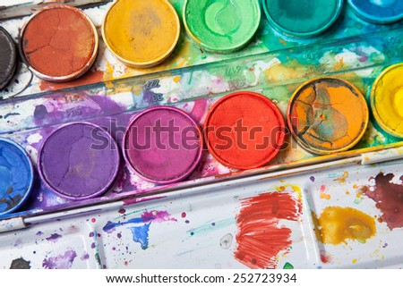 bright colors for watercolor painting in messy box - stock photo