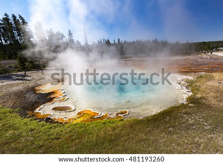 Bright colors of hot springs. Incredible blue lake. The reds, yellows and browns of the mud in Fountain Paint Pots. Yellowstone National Park, Wyoming