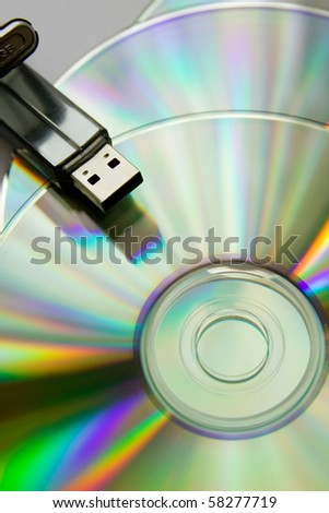 Bright  colourful cd disks with USB flash - stock photo