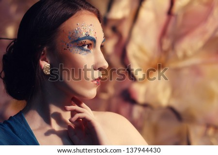 Bright creative Make-up.Beautiful Woman's Face - stock photo