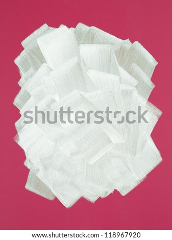 Bright crimson wall painted in white color with paint roller. Brush strokes texture. - stock photo