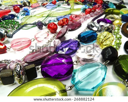 bright crystals beads and rings  fashion background - stock photo