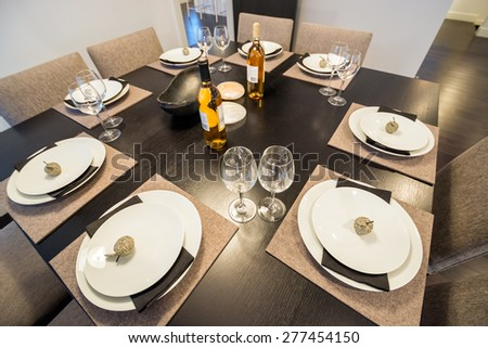 Bright dining room table set for dinner. Interior design.