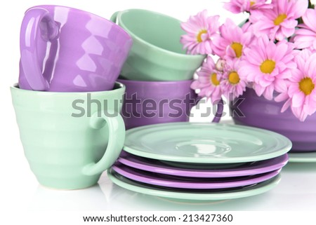 Bright dishes with flowers isolated on white - stock photo