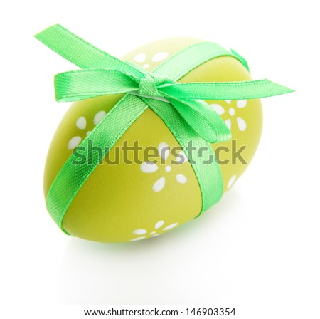Bright easter egg with bow, isolated on white - stock photo