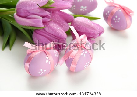 Bright easter eggs and tulips, isolated on white - stock photo